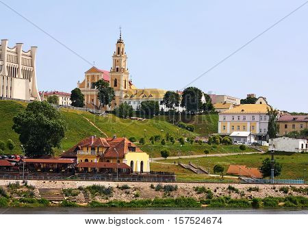 View of the historical part of the Belarusian city Grodno with baroque catolical church and old-time constructions in the distant run