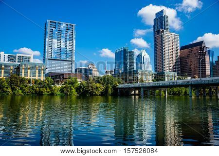 Austin Texas Mirror Image Skyline Cityscape on Town Lake during a nice day in Summer Capital Cities Frost Bank Tower view