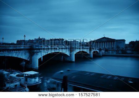 Paris River Seine with Pont de la Concorde and Assemblee Nationale at sunset