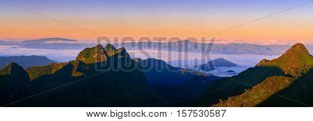 Mountain Mist In Sunrise. Panorama Shot.