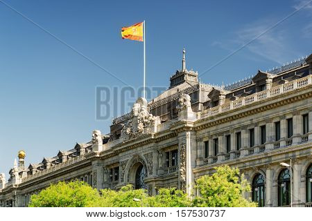 Flag Of Spain Fluttering On Building Of Bank Of Spain In Madrid