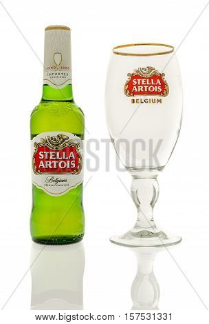 Winneconne WI - 20 November 2016: Bottle of Stella artois beer with an empty chalice on an isolated background.