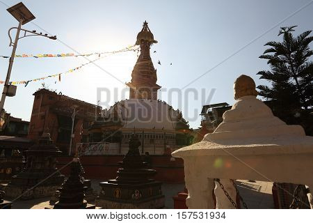 KATHMANDU NEPAL - NOV 06 2016: Buddha Stupa with Buddha wisdom eyes and prayer colorful flags in thamel Kathmandu Nepal