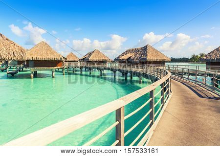 Traditional over water villas on a tropical lagoon of Bora Bora Island Tahiti French Polynesia