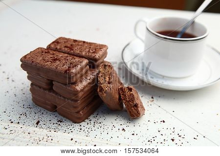 Cup of coffee with biscuit cookies, Chocolate biscuit cookies. Chocolate cookies on white table. Coffee break , breakfast.