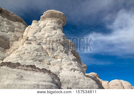 A white clay hoodoo rises against the sky in the Paint Mines Interpretive Park near Calhan Colorado USA. The clay in these formations was used by Native Americans in making pottery.