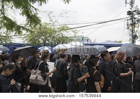 BANGKOK THAILAND - OCT 29 : The mourners in queue at sanam luang while the funeral of king Bhumibol Adulyadej in Grand Palace on october 29 2016