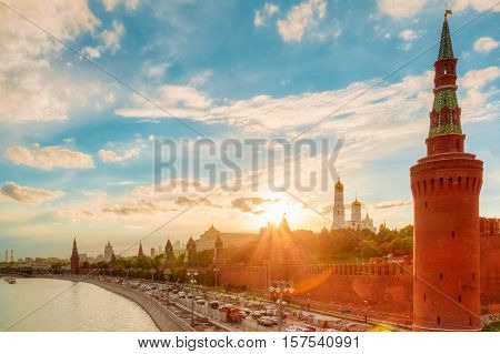 Sunset over the Kremlin embankment. Kremlin churches at sunset sky background