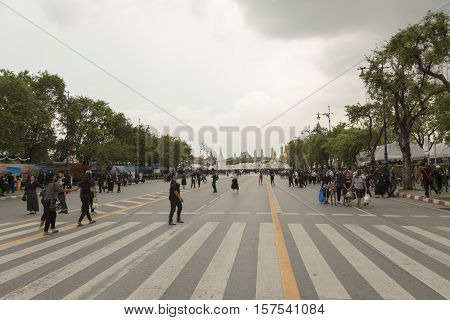 BANGKOK THAILAND - OCT 29 : A mourners on Ratchadamnoen Nai road in Sanam Luang area while the funeral of king Bhumibol Adulyadej in Grand Palace on october 29 2016