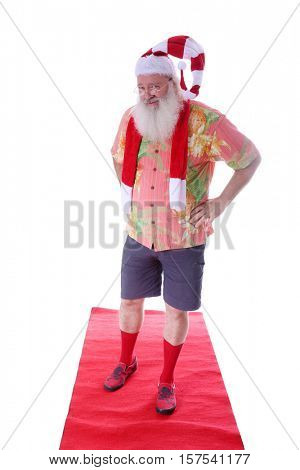 Hipster Santa Claus walks the Red Carpet in his Fashion Red Carpet Photo Shoot. Isolated on white with room for your text.