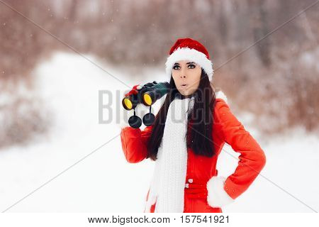 Surprised Girl with Binoculars Looking for Christmas