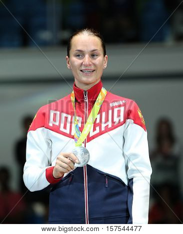 RIO DE JANEIRO, BRAZIL - AUGUST 8, 2016: Silver medalist Sofya Velikaya of Russian Federation during medal ceremony Women`s Sabre Individual final at Rio 2016 Olympic Games at the Carioca Arena 3