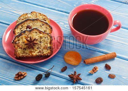 Cup Of Coffee And Fresh Baked Fruitcake On Boards