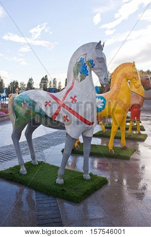 ASTANA, KAZAKHSTAN - July 17, 2016: Art installation in the form of figures of horses, painted in ornament ethnos , living in Kazakhstan