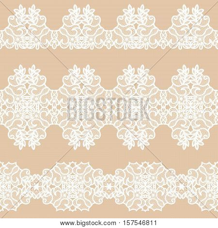 Set of white lace tape on a beige background