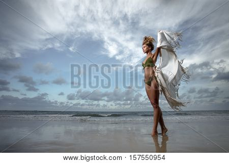 Young adult  girl on tropical beach.