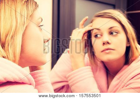 Blonde Woman Cleanse Her Face Before Make-up. Girl Wearing In Dressing-gown