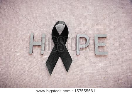 HOPE word with black ribbon for Skin cancer awareness Melanoma AwarenessNarcolepsy Awareness and Mourning