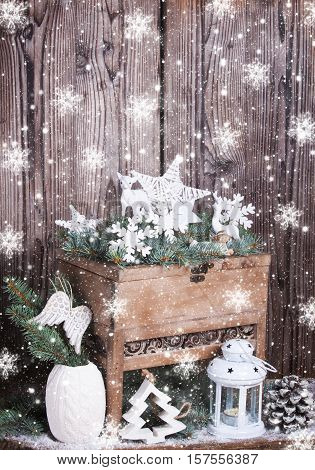 White Christmas decoration in front of wood