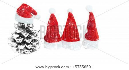 Four christmas hats on a white background