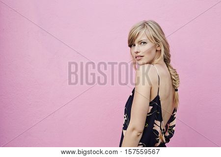 Stunning blond woman looking over shoulder portrait