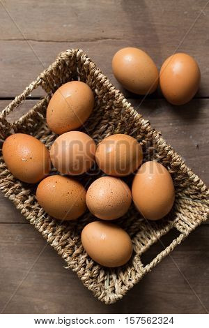 Fresh eggs on the wood background, chicken eggs.