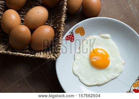 Fried Egg On Cooked Rice And Fresh Eggs.