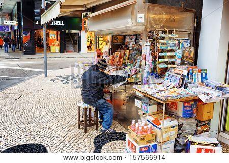Street Vendor Of Newspapers In Macau