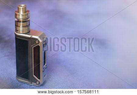 Modern electronic mod vaping device. New vaporizer e-cig gadget to vape e-liquid. Quit smoking nicotine cigarette