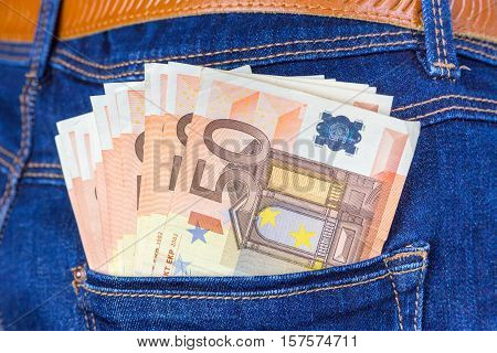Blue jeans back pocket with euro notes