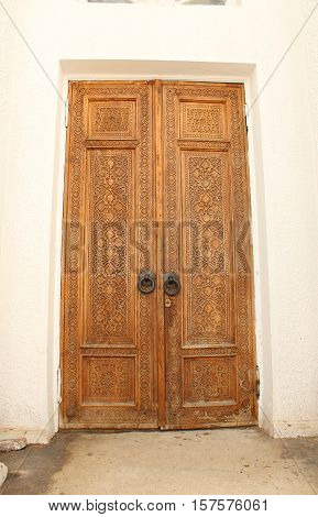 Old carved entrance door to the pavilion