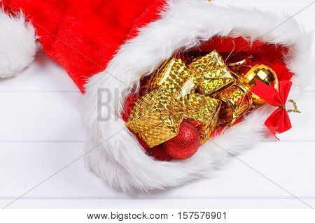 Christmas hat with Christmas decorations on white