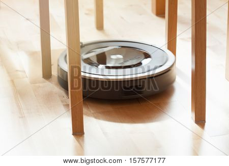robotic vacuum cleaner on laminate wood floor smart cleaning technology problem