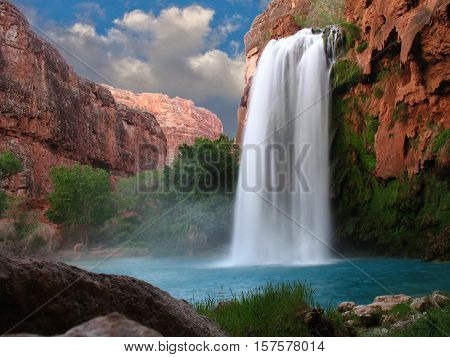 Nature Landscape Of Waterfall Cascade. River Waterfall Is Popular Travel Place.