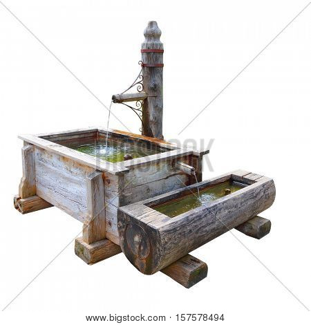 Rustic wooden well with splashing water isolated on white background. Fountain as a source drinking water. Object with clipping path.