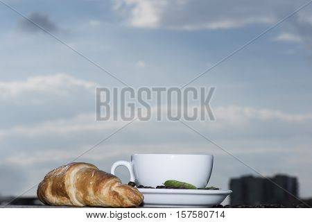 Cup Of Coffee Or Tea With Croissant