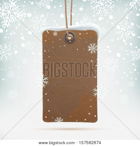 Blank, realistic, vintage price tag on winter background wit snow and snowflakes. Vector illustration.
