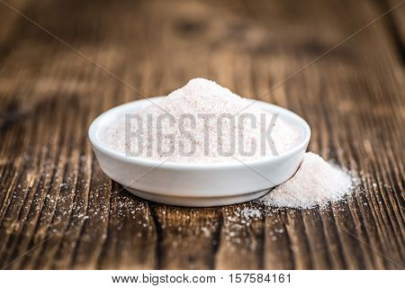 Wooden Table With Pink Salt (selective Focus)