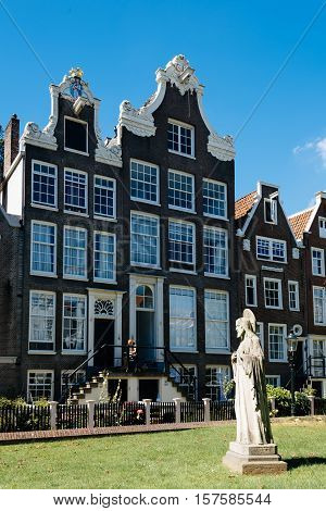 Amsterdam Netherlands - August 1 2016: Begijnhof. It is one of the oldest inner courts in the city of Amsterdam. A group of historic buildings centre on it.
