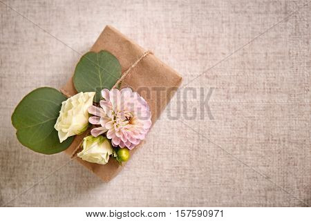 Handcrafted gift box with flowers on table
