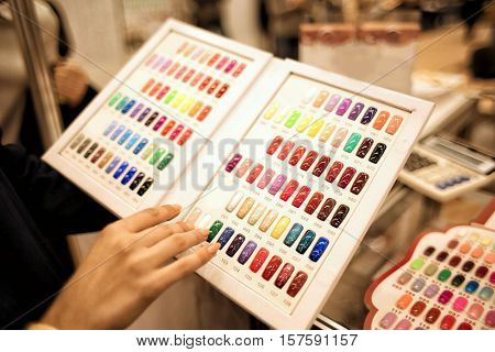 Set of different nail polish colours on palette in cosmetic store
