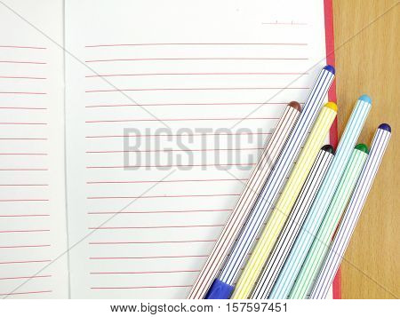 Pen And Notebook On Wooden Table Business Education