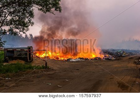 Burning garbage in the landfill solid waste. Fire.