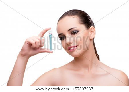 Woman with bottle of healing solution isolated on white