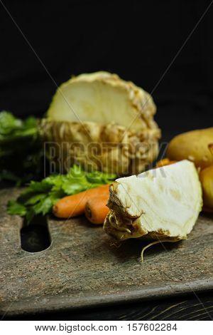 Ingredients for celeriac soup - celery root - celeriac carrots onion potatoes - healthy diet concept