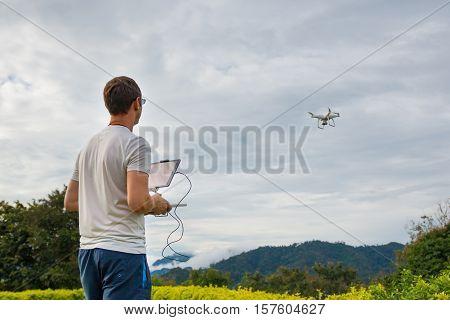 PHUKET THAILAND - 8.11.2016: Man with remote controlling drone DJI Phantom 4 in Phuket Thailand