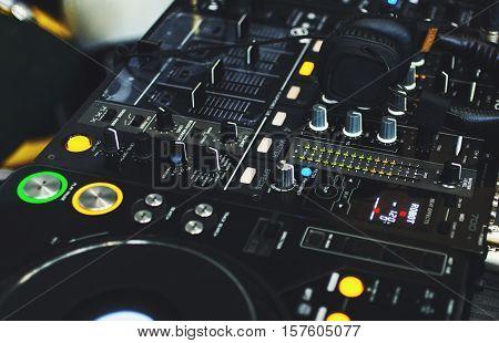 DJ console with DJ headphones close up.