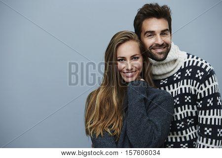 Loving couple in knitwear fashion portrait studio shot