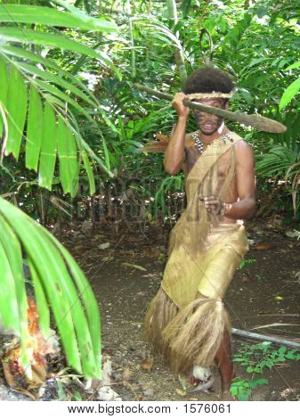 Melanesian In Native Traditional Dress Threatening With Spear. Vanuatu.