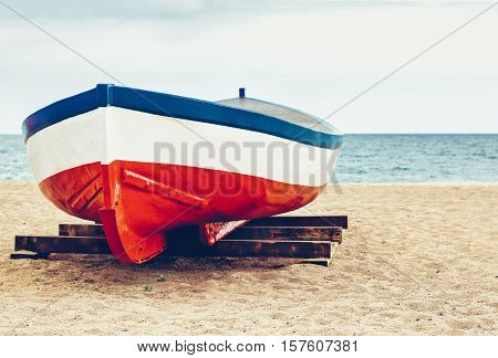 Fisher boat at sand on the beach